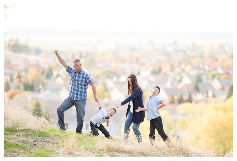 Family doing a happy dance on photoshoot